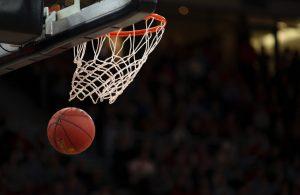 basketball flying into hoop